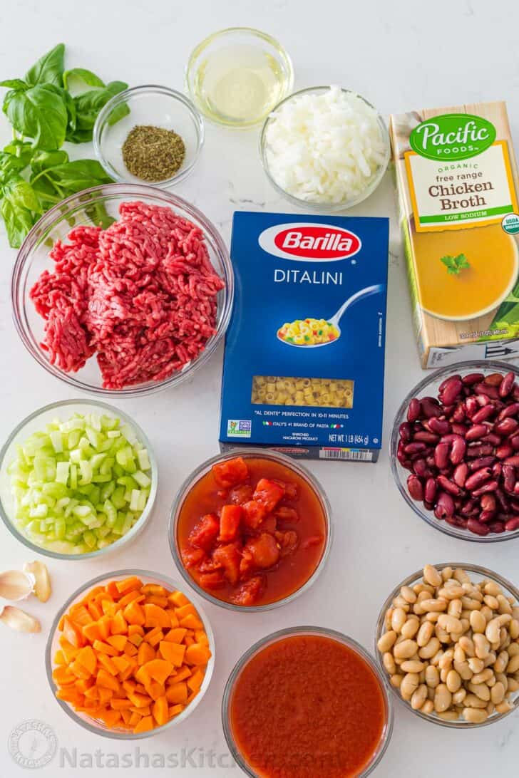 Ingredients for soup with ditalini pasta, ground beef, beans, tomatoes and broth