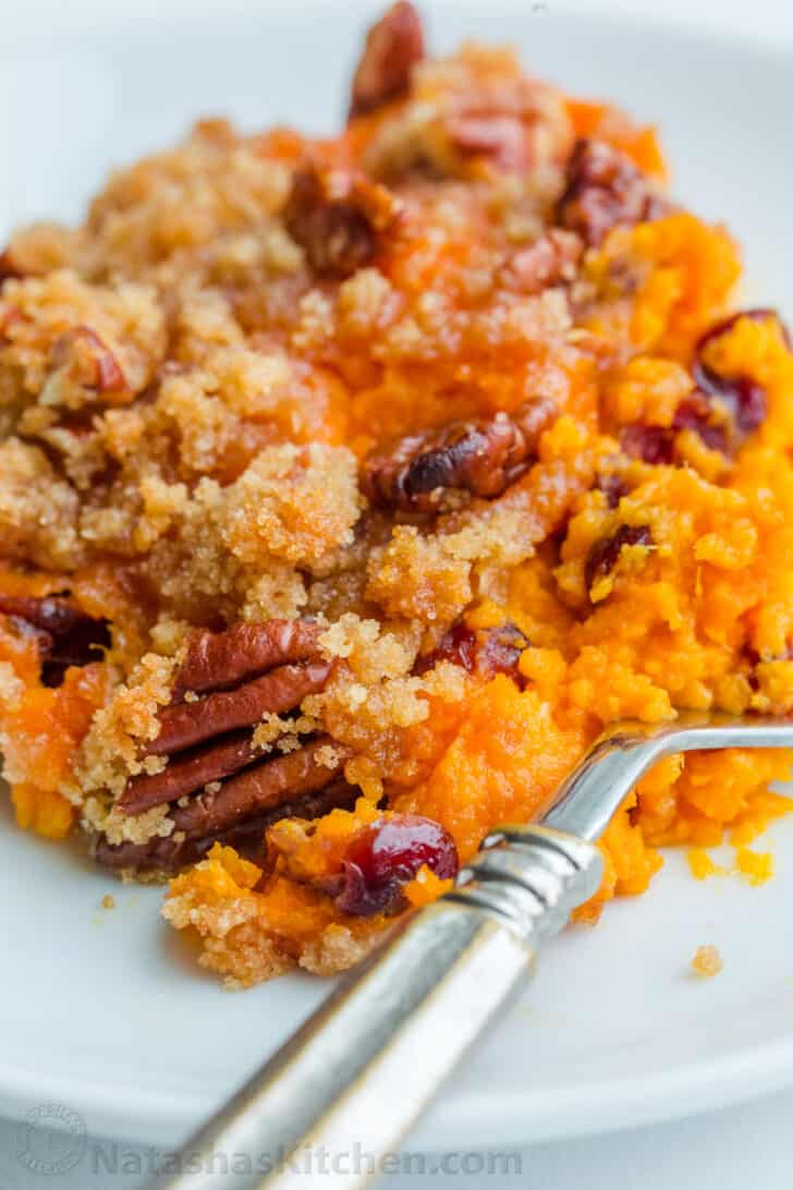 Sweet Potato Casserole portion on a plate with a fork