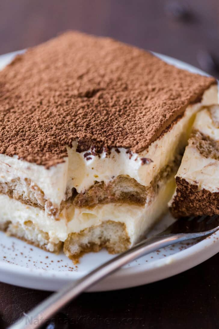 Tiramisu with layers of lady fingers and mascarpone cream on a plate