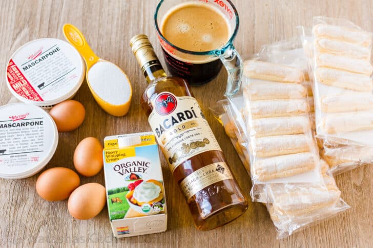 Ingredients for Italian dessert including lady fingers, coffee, cream, mascarpone, eggs and sugar