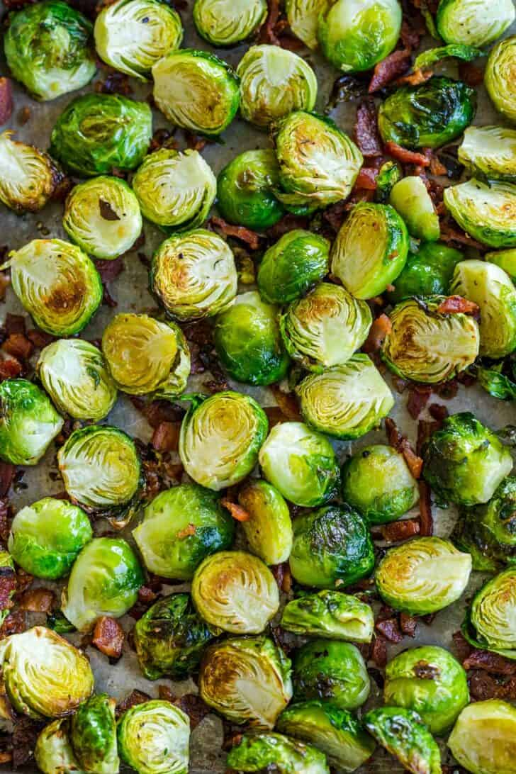 Roasted Brussels sprouts on baking sheet with bacon