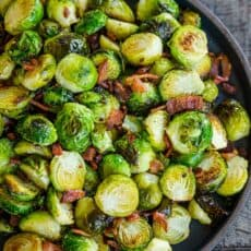Roasted brussels sprouts in a bowl with bacon