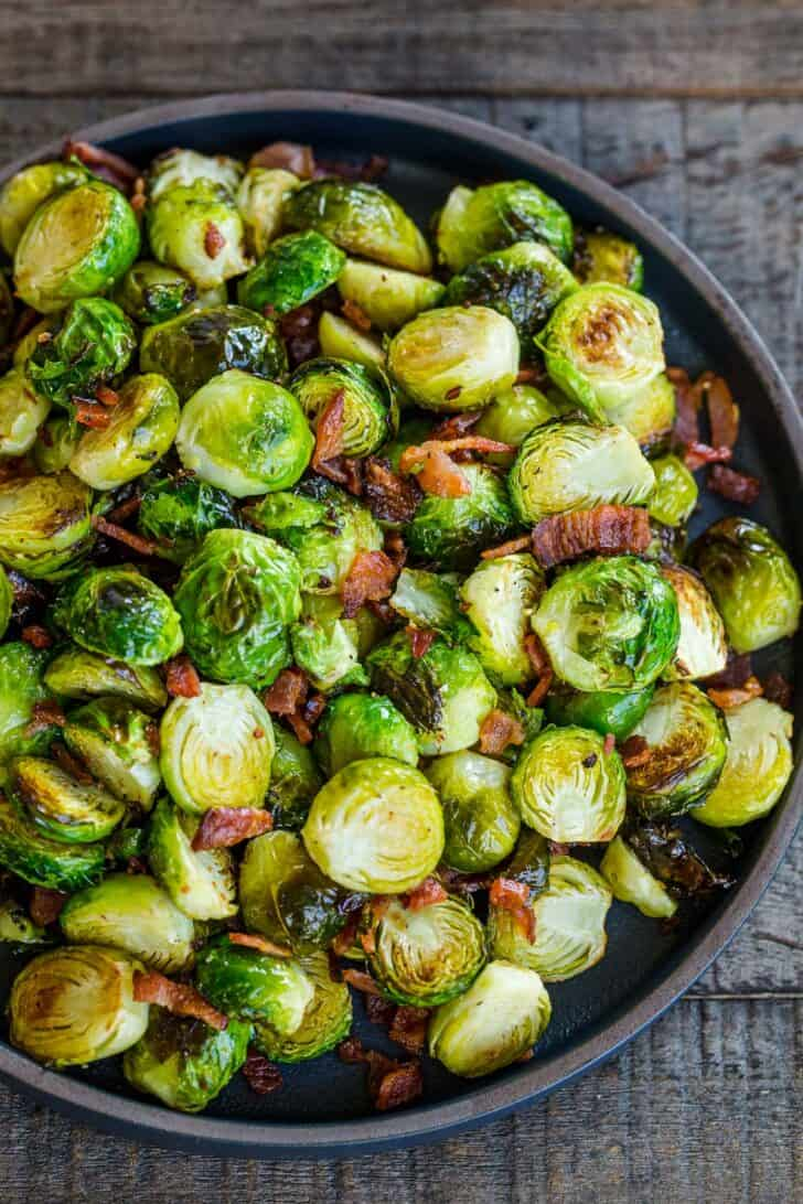 Roasted Brussels Sprouts recipe in a bowl with bacon
