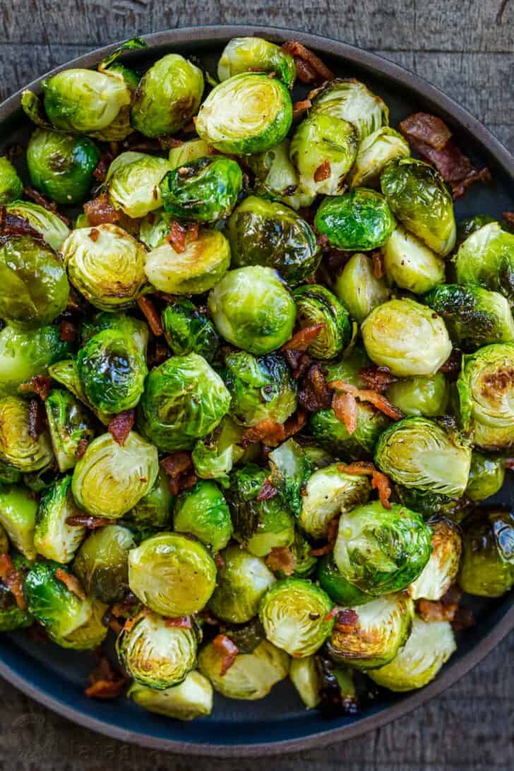 Roasted Brussels sprouts in a bowl ready to be stored