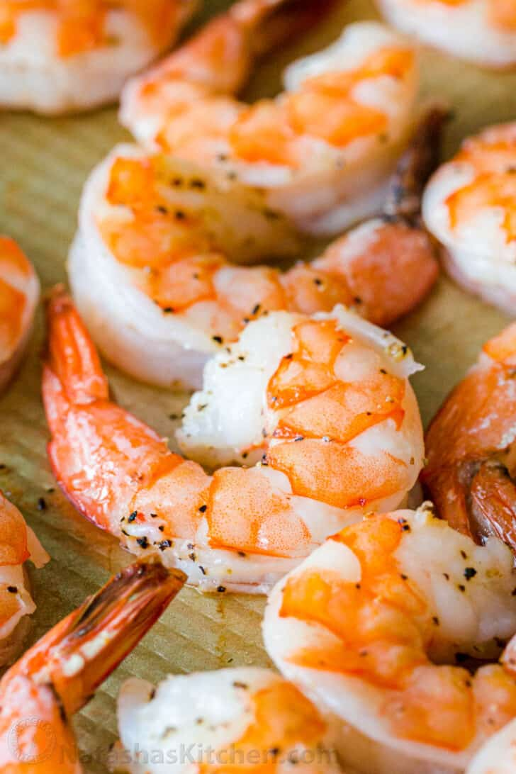 Close up of peeled and deveined baked shrimp with tail on