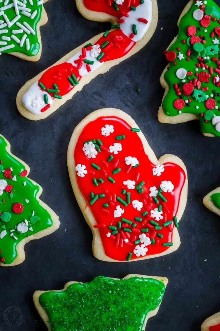 Sugar cookies decorated with frosting and festive holiday sprinkles