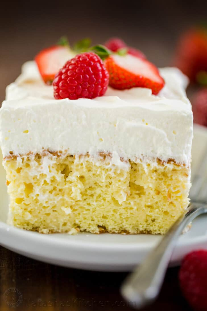 Slice of Tres Leches Cake on a plate with fork