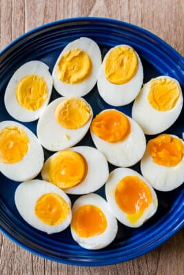 boiled eggs on a platter with hard boiled eggs, medium boiled eggs and soft boiled eggs