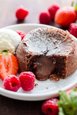 Chocolate Lava cake dusted with powdered sugar with molten center and served with ice cream and berries