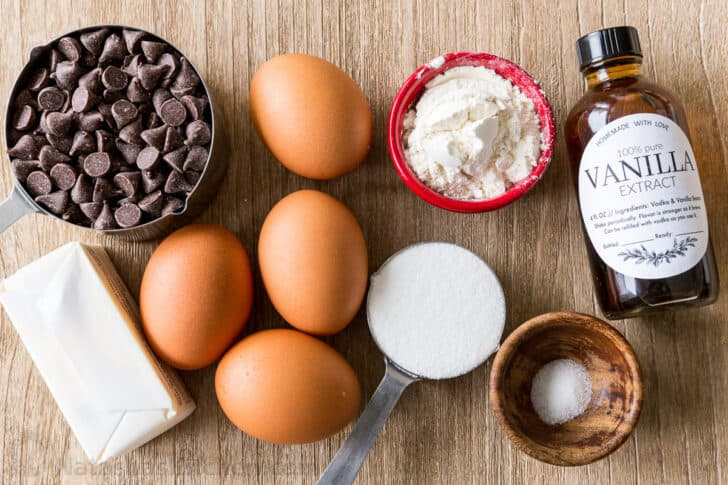 Ingredients for molten chocolate lava cake with chocolate chips, eggs, butter, sugar, salt, flour and vanilla extract