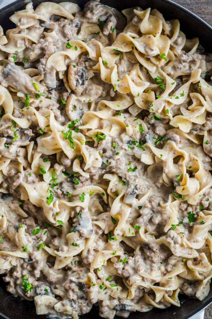 Ground Beef Stroganoff in a serving dish with pasta