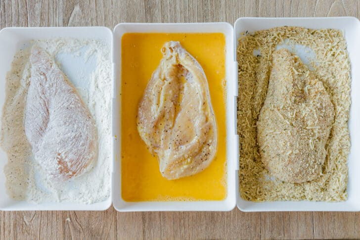 Chicken breading bowls with flour, egg and crumb mixture