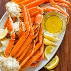 Crab legs served on platter with butter dipping sauce