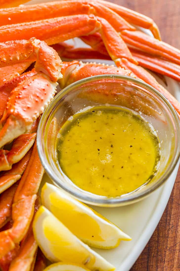 Crab Dipping Sauce in ramekin surrounded by crab legs