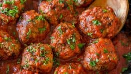 Meatballs in skillet with marinara sauce