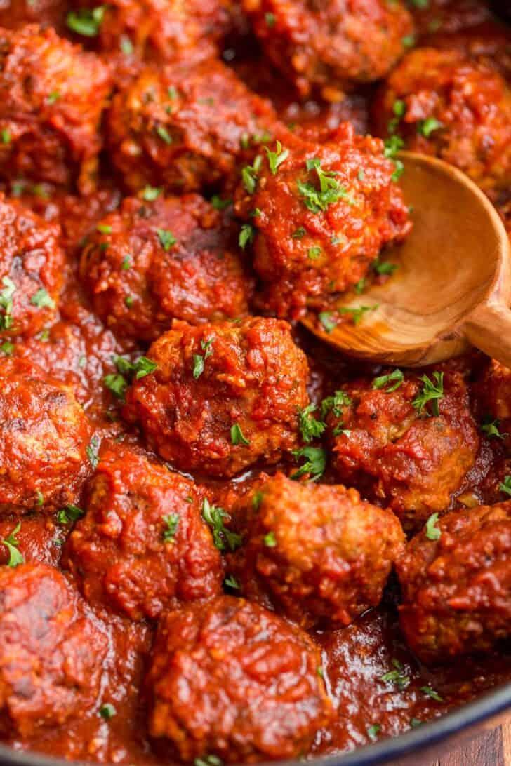 Frozen and reheated meatballs in marinara sauce