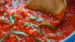 Marinara Sauce in Saucepan garnished with basil for Italian marinara