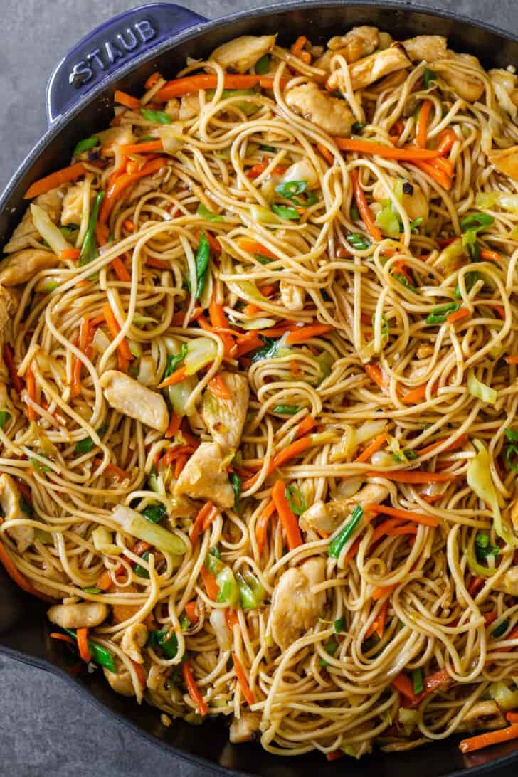 Chicken chow mein in a pan.