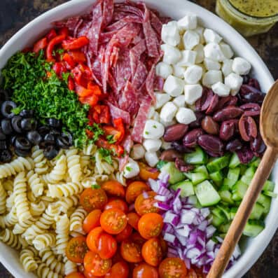 Italian pasta salad in serving bowl with Italian dressing