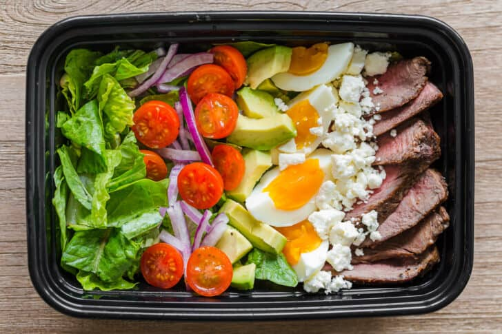 Steak cobb salad in meal prep container