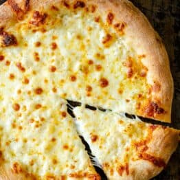 Pizza dough baked with cheese and white sauce