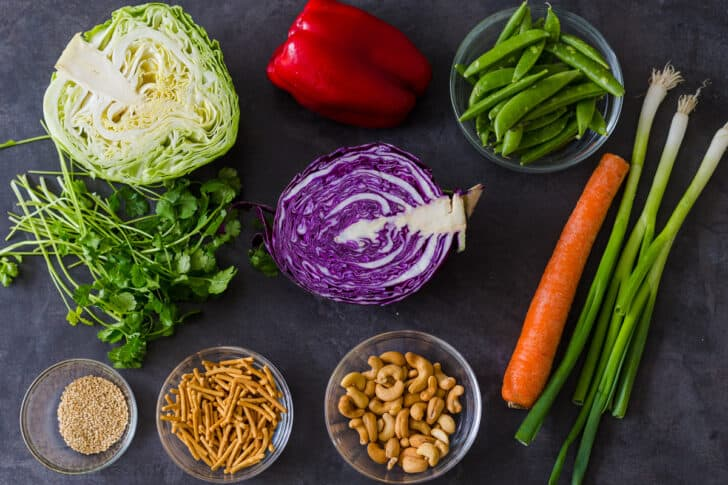 Ingredients for the Asian Chopped Salad with cabbage, bell pepper, chow mein noodles, green onion, sweet peas and carrot