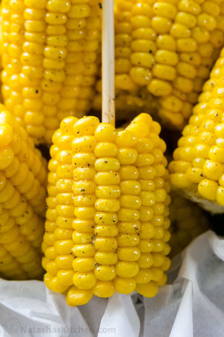 Close up of boiled corn on the cob with butter and black pepper