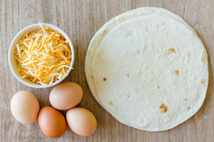 Ingredients for egg quesadillas with tortillas, eggs, cheese