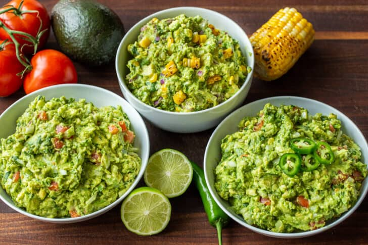 3 bowls of guacamole with classic guac, corn guac and spicy guac