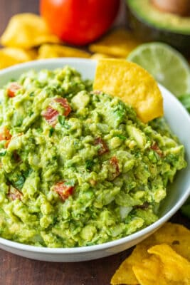 authentic guacamole loaded with avocados, tomato, onion, cilantro, plenty of lime juice, salt and pepper.