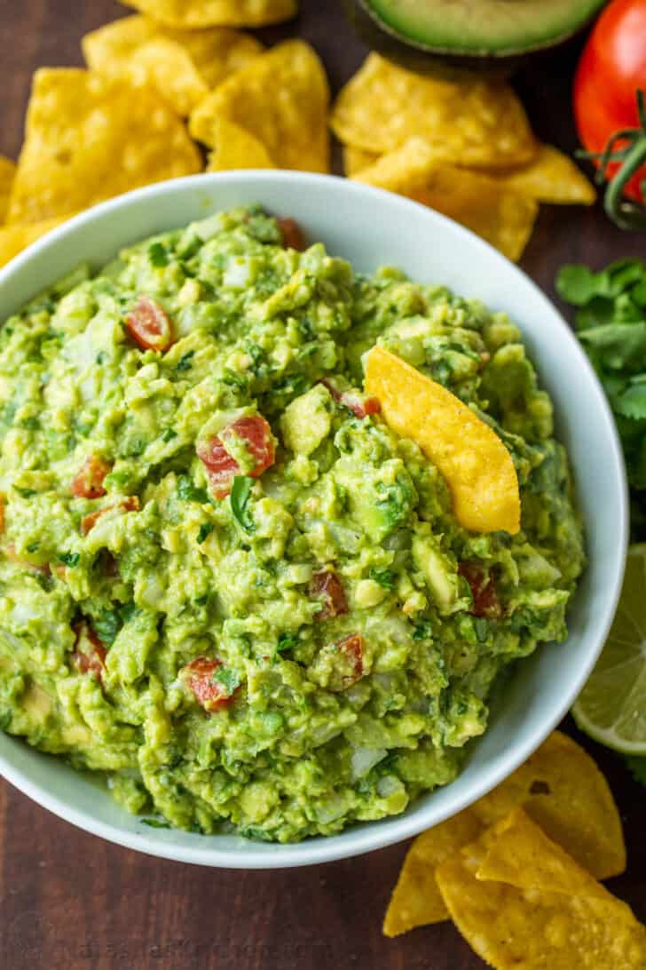 Guacamole prepared in a bowl served with tortilla chips