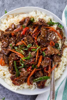 Mongolian beef and vegetables over white rice