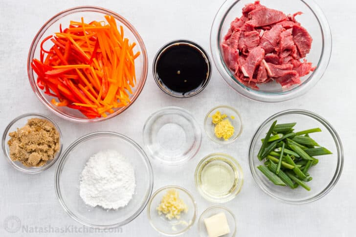 Ingredients for Mongolian Beef in ramekins sliced and sauce ingredients measured out.