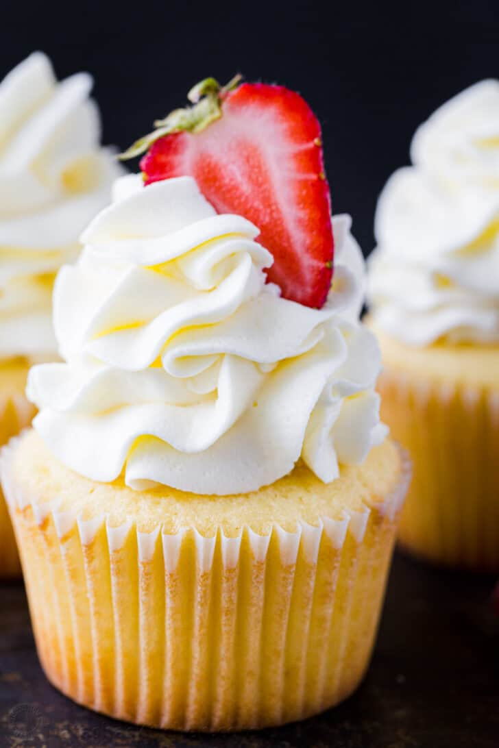 Vanilla Cupcake with Vanilla frosting decorated with a strawberry