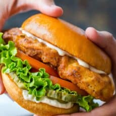 crispy chicken sandwich in hands