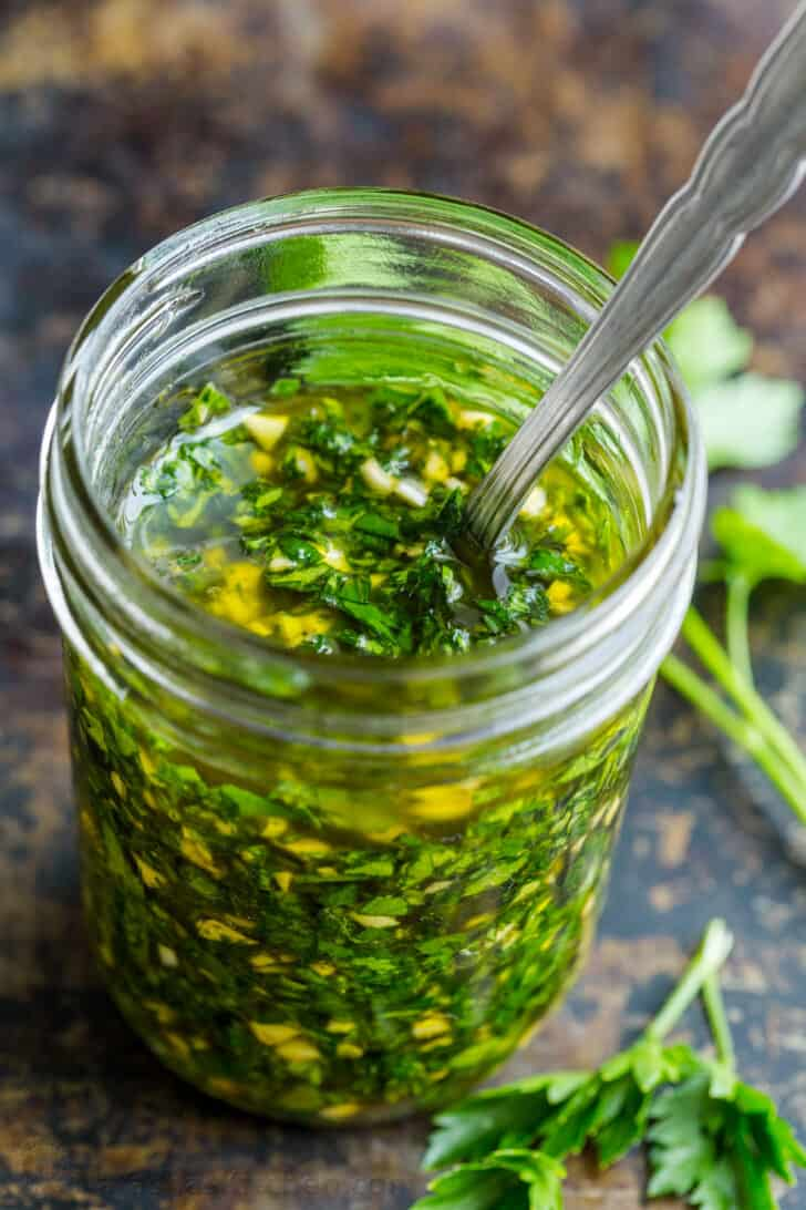 Chimichurri sauce in a mason jar ready for serving