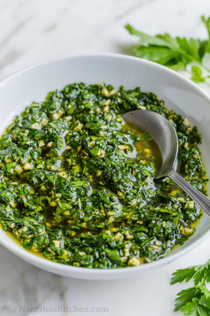 Chimichurri Sauce in bowl with spoon