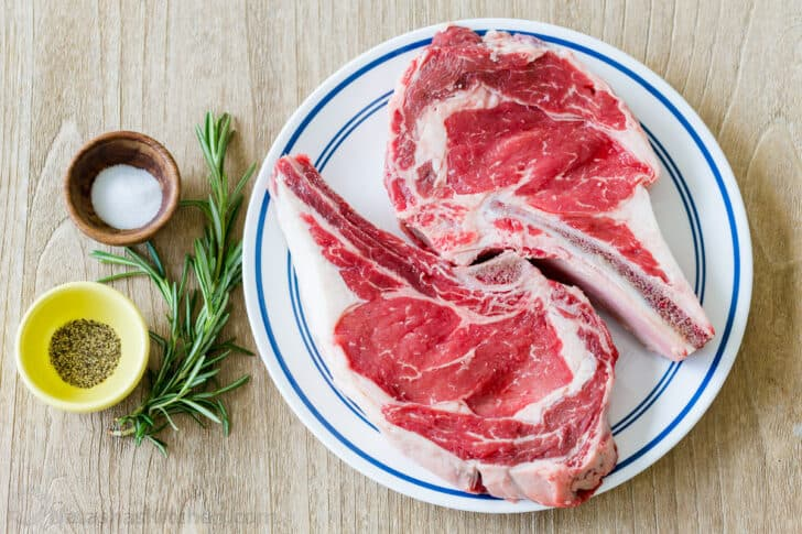 Ribeye Steaks for grilling with rosemary, salt and pepper