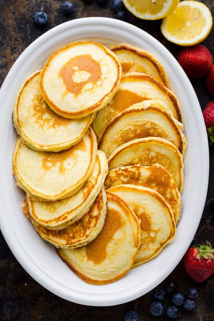 Cooked lemon ricotta pancakes on a serving platter