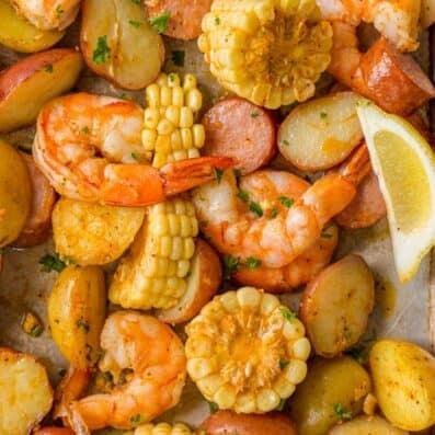 Shrimp Boil Recipe on Sheet Pan with lemon wedges