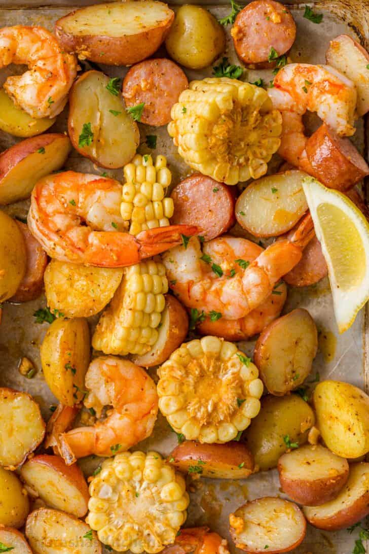 Shrimp boil with shrimp, corn and potatoes baked on a sheet pan