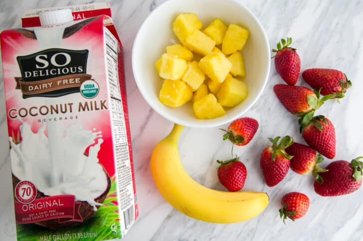 Coconut milk, frozen pineapple, bananas, and strawberries to make this simple and delicious Strawberry Smoothie recipe.