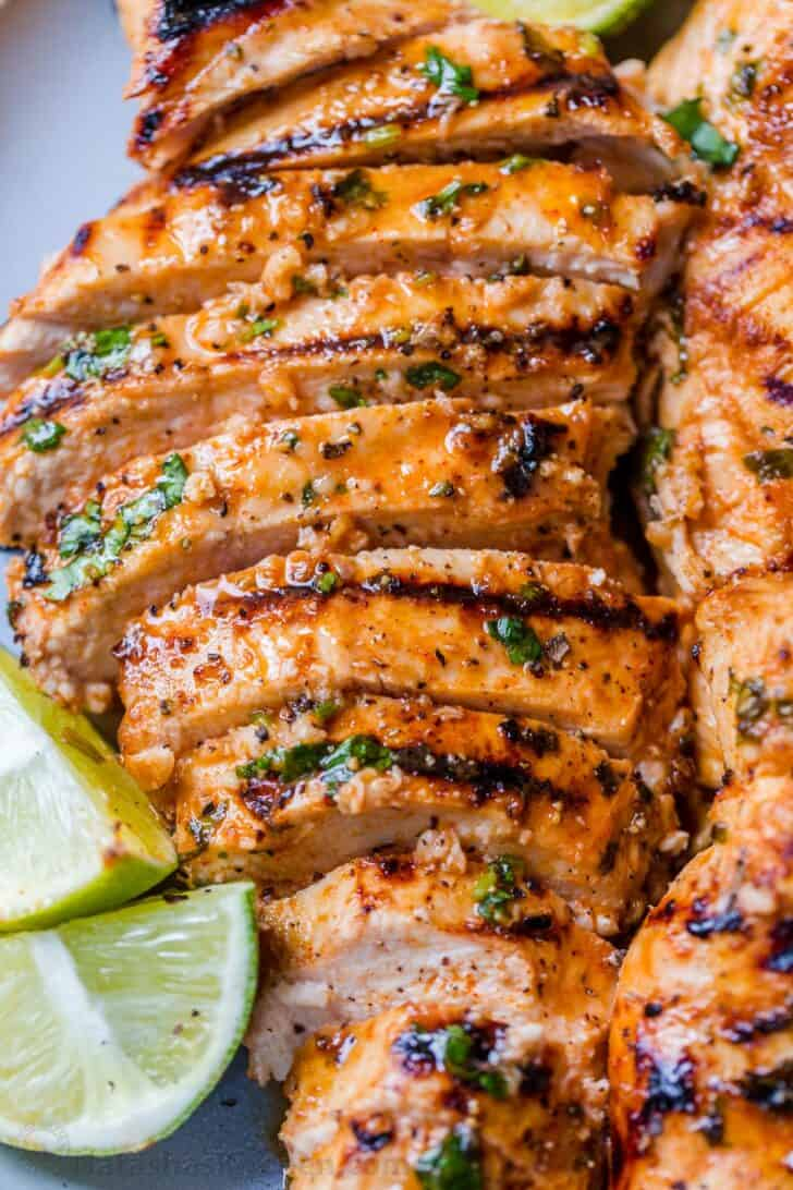 Sliced grilled chicken on a plate.