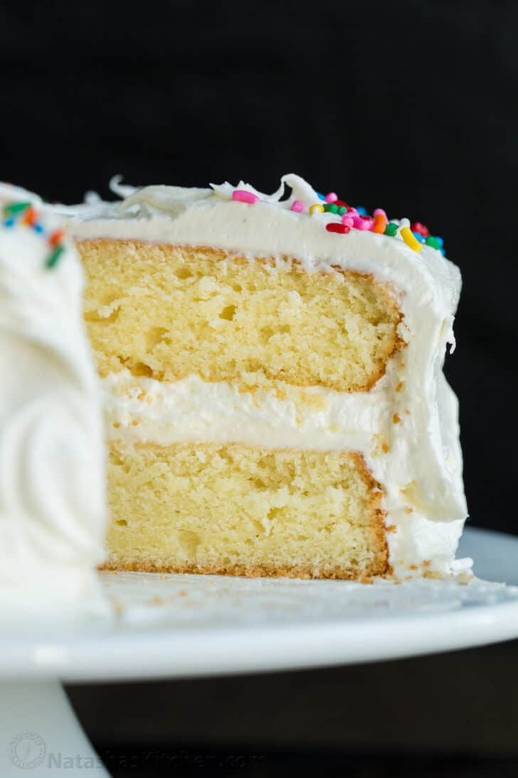 Sliced vanilla cake on cake platterf