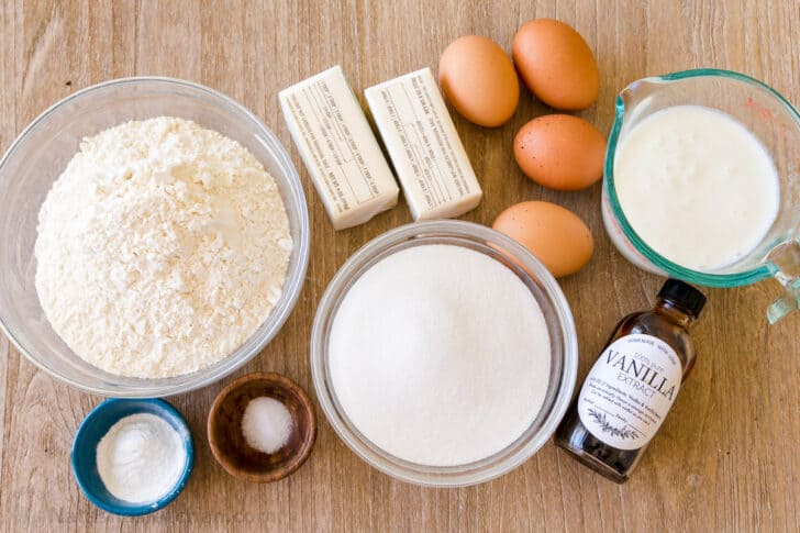 Ingredients for vanilla cake with flour, butter, eggs, sugar, baking powder, salt and buttermilk