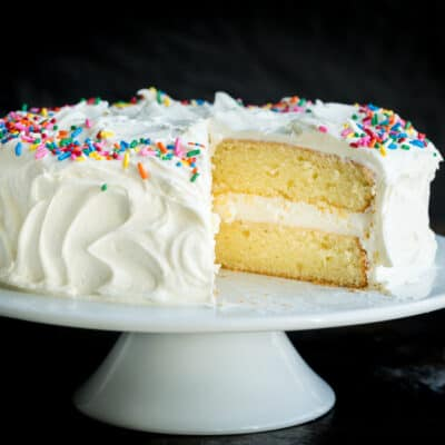 Vanilla Cake Recipe with cut slice