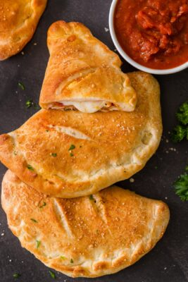 Baked Calzones served with marinara sauce