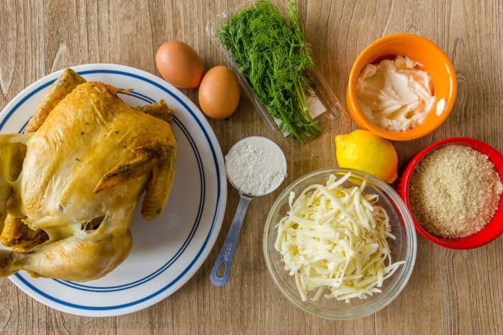 Ingredients for chicken patties with rotisserie chicken, cheese, egg, dill, bread crumbs and lemon