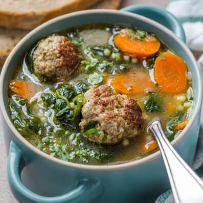 Italian Wedding Soup in a bowl with a spoon