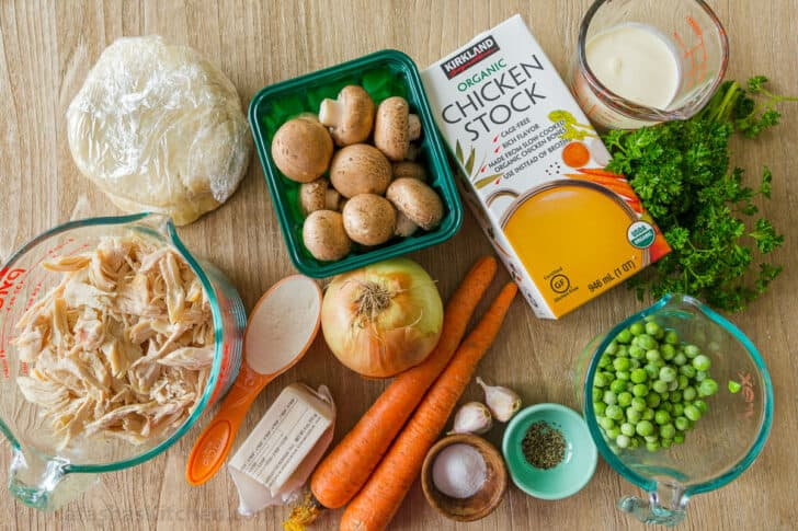 Ingredients for chicken pot pie with chicken, mushrooms, carrot, onion